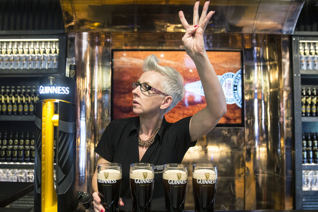 Honora Cosley, a perfect pint ambassador, rings up four pints of Guinness on Thursday, March 2, 2017, at The Guinness Experience at the Guinness Store in the Mandalay Bay hotel-casino, in Las Vega ...