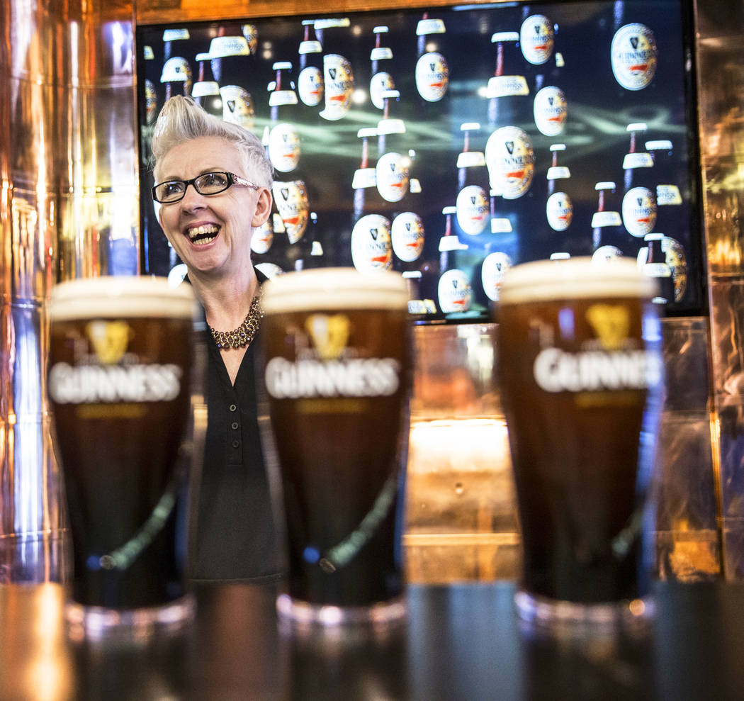 Perfect pint ambassador Honora Cosley shares a laugh with a customer on Thursday, March 2, 2017, at The Guinness Experience at the Guinness Store in the Mandalay Bay hotel-casino, in Las Vegas. (B ...