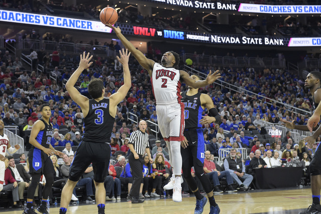 UNLV guard Uche Ofoegbu puts up a shot over Duke guard Grayson Allen during their NCAA basketball game Saturday, Dec. 10, 2016, at the T-Mobile Arena in Las Vegas. Duke won 94-45. Sam Morris/Las V ...