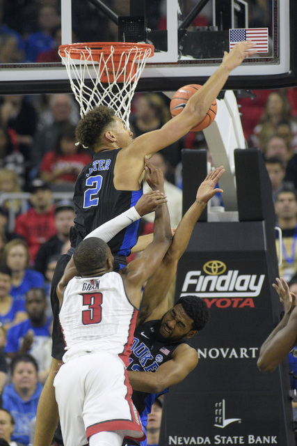 Duke forward Chase Jeter rejects a shot by UNLV forward Tyrell Green during their NCAA basketball game Saturday, Dec. 10, 2016, at the T-Mobile Arena in Las Vegas. Duke won 94-45. Sam Morris/Las V ...