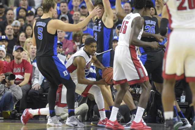 UNLV guard Larry Bush gets trapped by Duke guard Luke Kennard, left, and Duke guard Grayson Allen during their NCAA basketball game Saturday, Dec. 10, 2016, at the T-Mobile Arena in Las Vegas. Duk ...