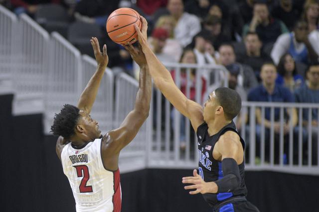 Duke forward Jayson Tatum blocks a shot by UNLV guard Uche Ofoegbu during their NCAA basketball game Saturday, Dec. 10, 2016, at the T-Mobile Arena in Las Vegas. Duke won 94-45. Sam Morris/Las Veg ...