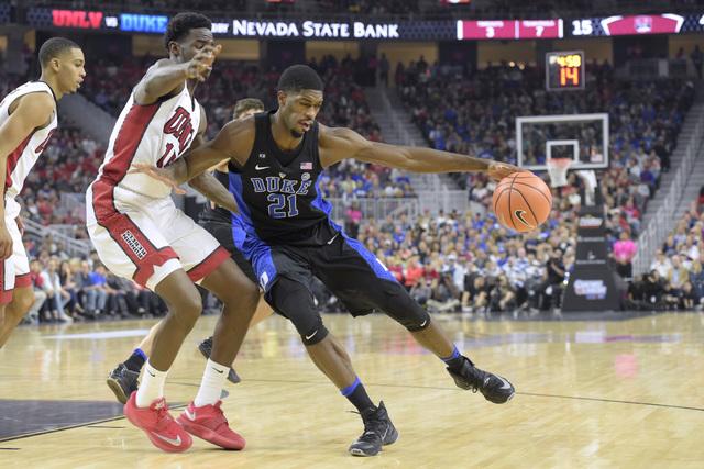 UNLV forward Dwayne Morgan defends Duke forward Amile Jefferson during their NCAA basketball game Saturday, Dec. 10, 2016, at the T-Mobile Arena in Las Vegas. Duke won 94-45. Sam Morris/Las Vegas  ...