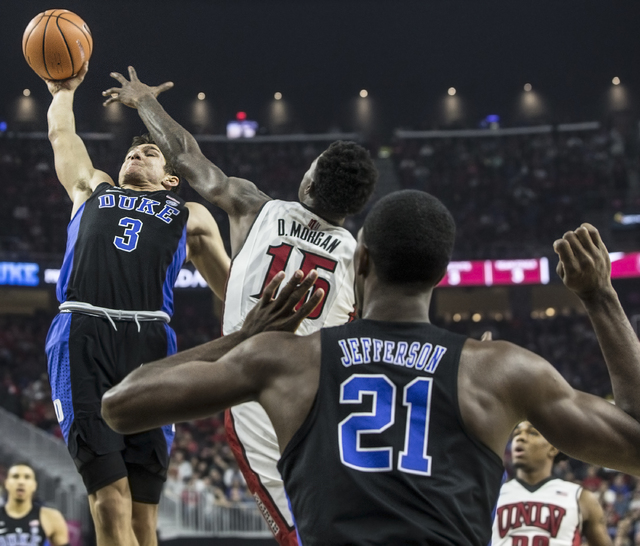 Duke's Grayson Allen (3) dunks over UNLV's Dwayne Morgan (15) during the Rebels home matchup with the Blue Devils at T-Mobile Arena on Saturday, Dec. 10, 2016, in Las Vegas. Benjamin Hager/Las Veg ...