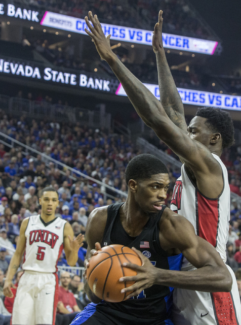 Duke's Amile Jefferson (21) drives past UNLV's Dwayne Morgan (15) during the Blue Devils road matchup with the Rebels at T-Mobile Arena on Saturday, Dec. 10, 2016, in Las Vegas. Benjamin Hager/Las ...