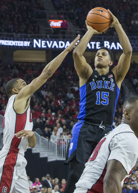 Duke's Frank Jackson (15) shoots over UNLV's Jalen Poyser (5) during the Blue Devils road matchup with the Rebels at T-Mobile Arena on Saturday, Dec. 10, 2016, in Las Vegas. Benjamin Hager/Las Veg ...