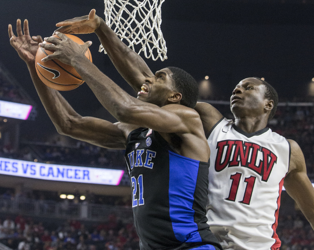 Duke's Amile Jefferson (21) drives past UNLV's Cheickna Dembele (11) during the Blue Devils road matchup with the Rebels at T-Mobile Arena on Saturday, Dec. 10, 2016, in Las Vegas. Benjamin Hager/ ...