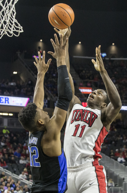 UNLV's Uche Ofoegbu (11) shoots over Duke's Javin DeLaurier (12) during the Rebels home matchup with the Blue Devils at T-Mobile Arena on Saturday, Dec. 10, 2016, in Las Vegas. Benjamin Hager/Las  ...