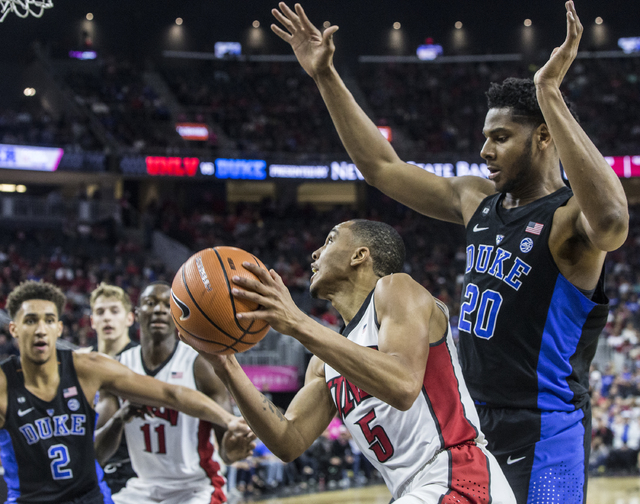 UNLV's Jalen Poyser (5) drives baseline around Duke's Marques Bolden (20) during the Rebels home matchup with the Blue Devils at T-Mobile Arena on Saturday, Dec. 10, 2016, in Las Vegas. Benjamin H ...