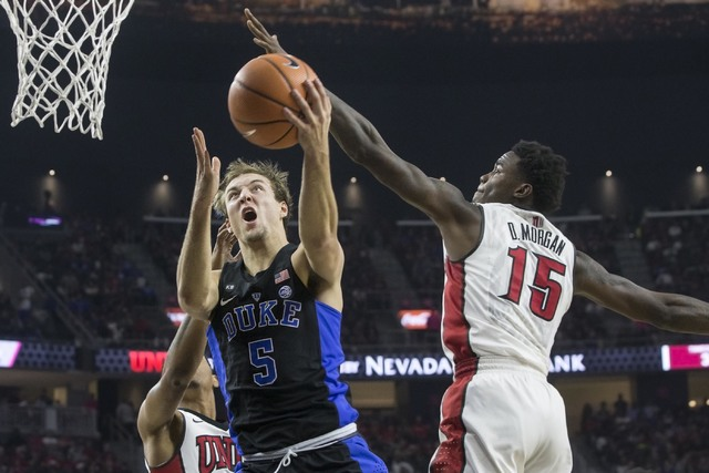 Duke's  Luke Kennard (5) drives past UNLV's Dwayne Morgan (15) during the Rebels home matchup with the Blue Devils at T-Mobile Arena on Saturday, Dec. 10, 2016, in Las Vegas. (Benjamin Hager/Las V ...