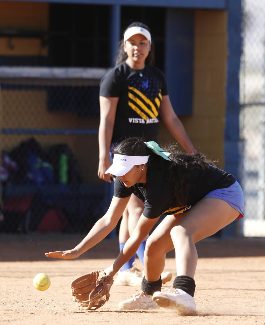 Sierra Vista High's Ryan Watkins prepares to catch a grounder as her sister Kalei Watkins looks on during team's practice on Friday, March 3, 2017, in Las Vegas. (Bizuayehu Tesfaye/Las Vegas Revie ...