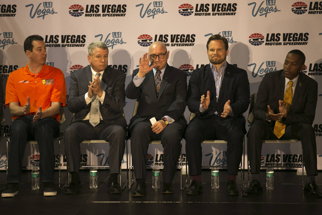Rossi Ralenkotter, president and CEO of the Las Vegas Convention and Visitors Authority, center, waves as he is introduces to members of the media during a news conference at Cashman Center on Wed ...