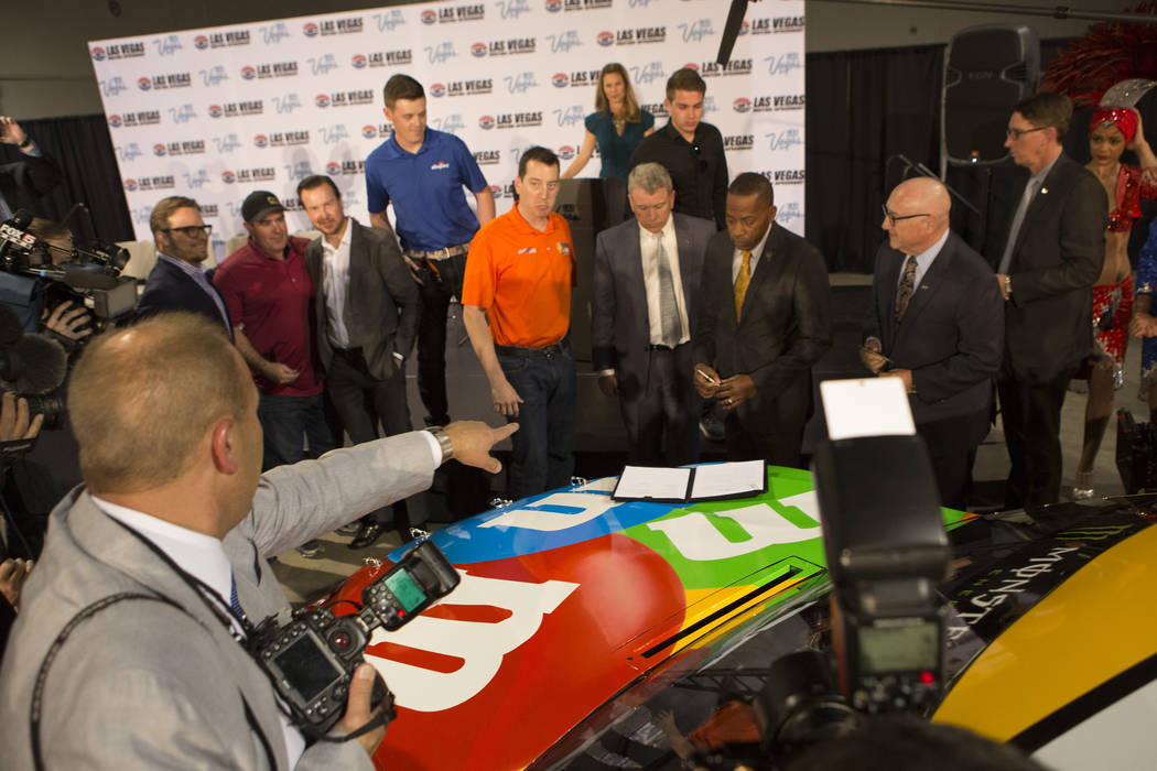 Individuals prepare for a photo opportunity at Cashman Center on Wednesday, March 8, 2017, in Las Vegas. It was announced that Las Vegas Motor Speedway will host a second NSCAR race in the fall st ...