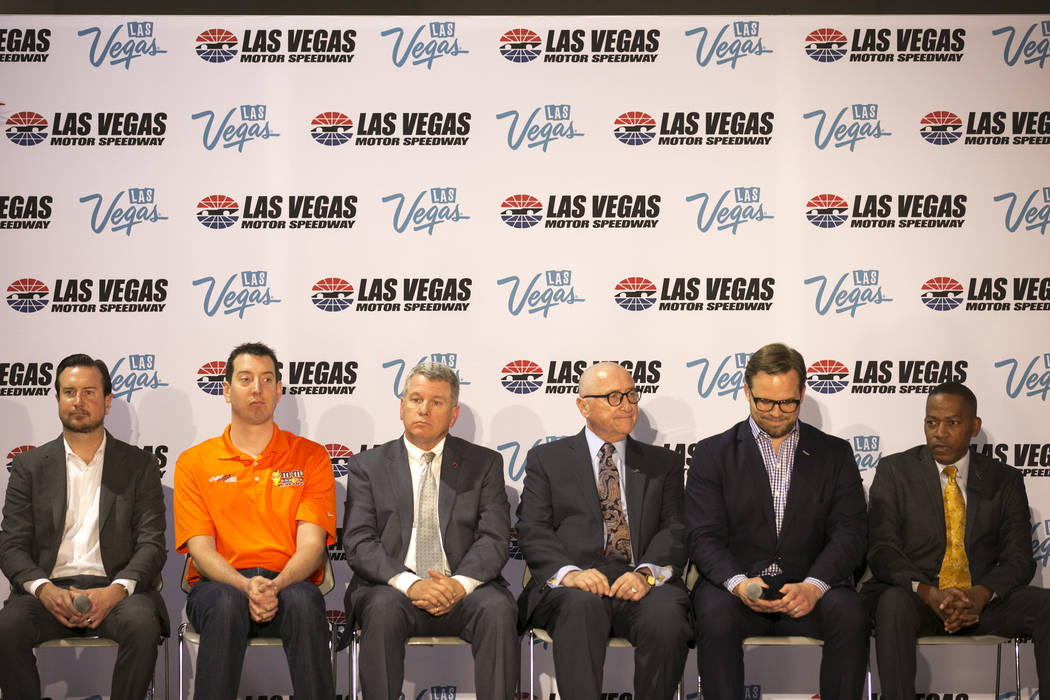 From left to right, race car driver Kurt Busch, race car driver Kyle Busch, general manager of the Las Vegas Motor Speedway Chris Powel, president and CEO of the Las Vegas Convention and Visitors  ...