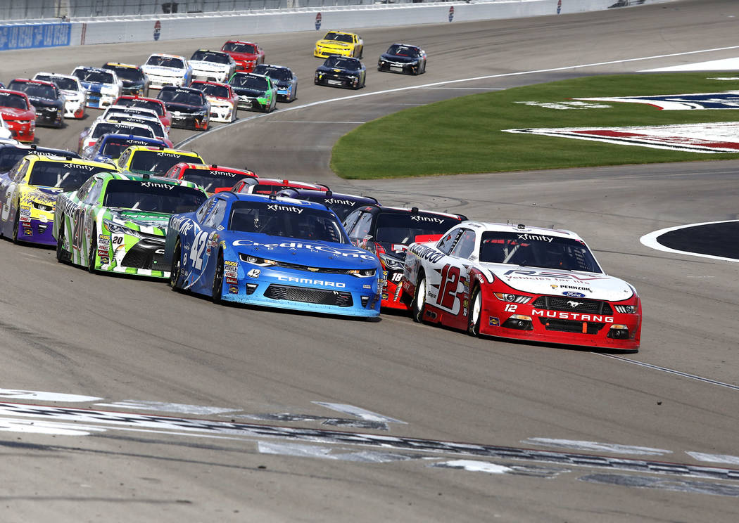 Joey Logano (12) leads Kyle Larson (42) as they run laps during the Boyd Gaming 300 NASCAR Xfinity Series auto race at Las Vegas Motor Speedway Saturday, March 11, 2017, in Las Vegas. (Christian K ...