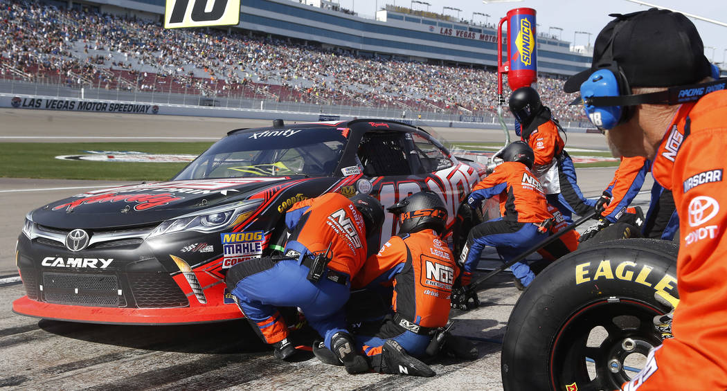 Kyle Busch (18) makes a pit stop during the Boyd Gaming 300 NASCAR Xfinity Series auto race at Las Vegas Motor Speedway Saturday, March 11, 2017, in Las Vegas. (Christian K. Lee/Las Vegas Review-J ...