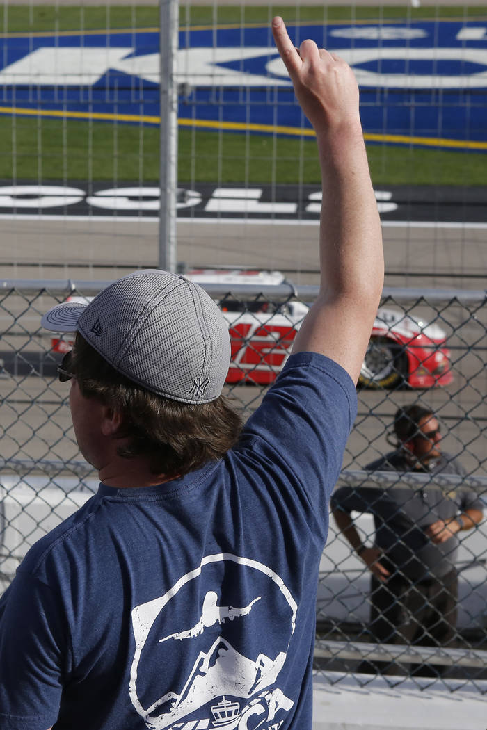 A fan cheers as Joey Logano (12) passes during the Boyd Gaming 300 NASCAR Xfinity Series auto race at Las Vegas Motor Speedway Saturday, March 11, 2017, in Las Vegas. (Christian K. Lee/Las Vegas R ...