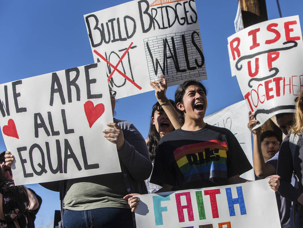 Dalia Becerra, right, cheers during a student rally in support of the BRIDGE Act on Tuesday, March 7, 2017, outside Rancho High School, in Las Vegas. The BRIDGE Act would provide Dreamers with a w ...