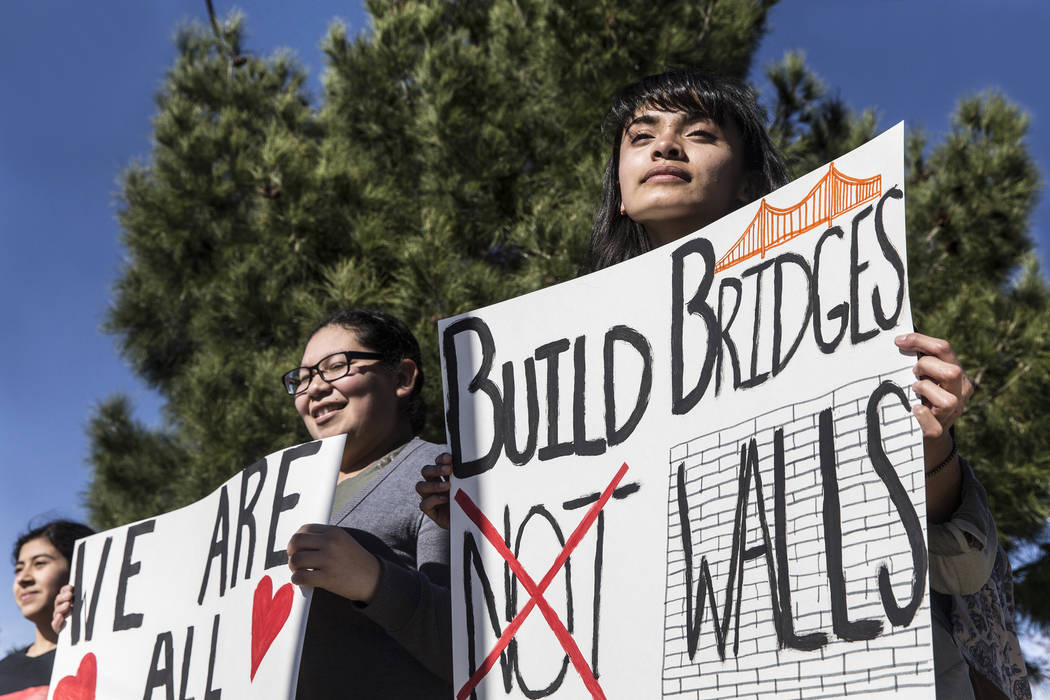 Erica Bonilla, right, stands with fellow students during a rally in support of the BRIDGE Act on Tuesday, March 7, 2017, outside Rancho High School, in Las Vegas. The BRIDGE Act would provide Drea ...