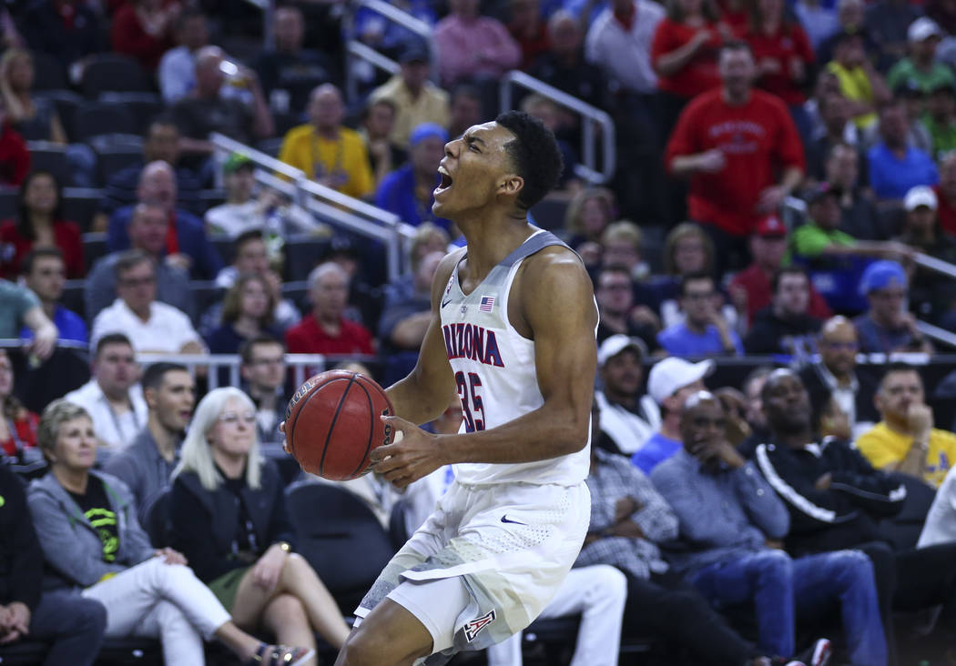 Arizona guard Allonzo Trier (35) celebrates while playing UCLA during the Pac-12 Conference basketball tournament semifinals at the T-Mobile Arena in Las Vegas on Friday, March 10, 2017. Arizona d ...