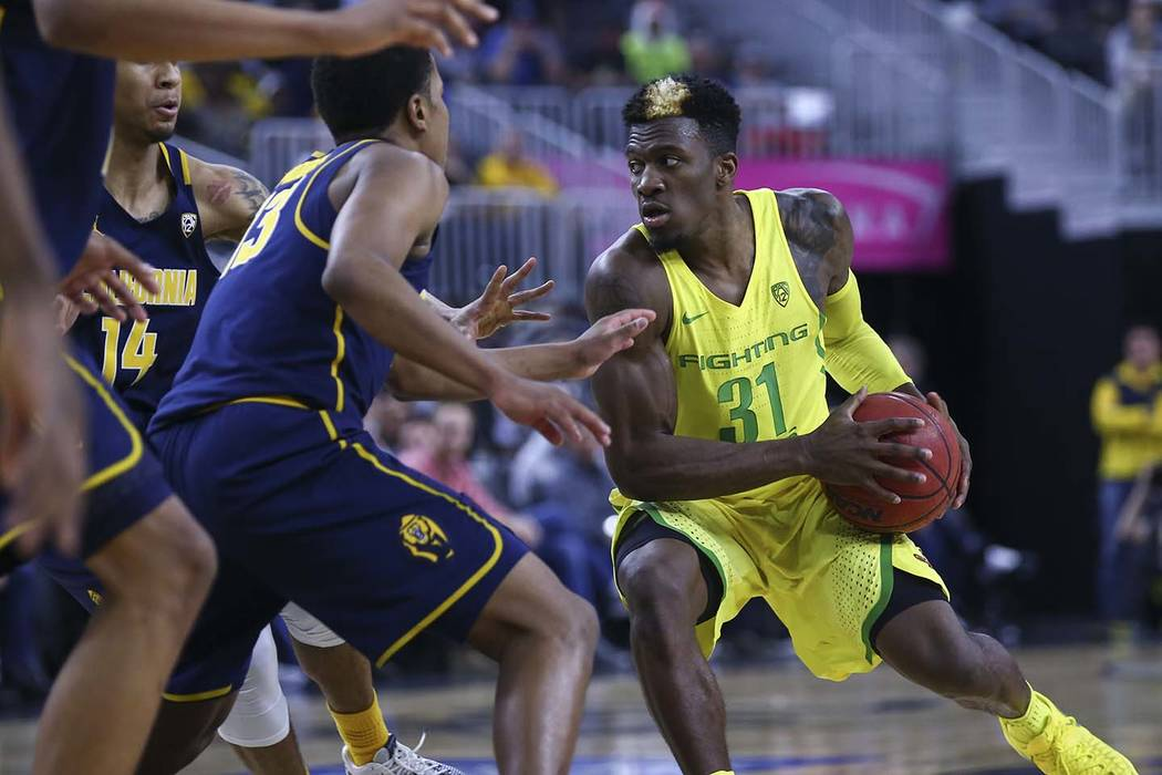 Oregon guard Dylan Ennis (31) drives against California during the Pac-12 Conference basketball tournament semifinals at the T-Mobile Arena in Las Vegas on Friday, March 10, 2017. Oregon defeated  ...