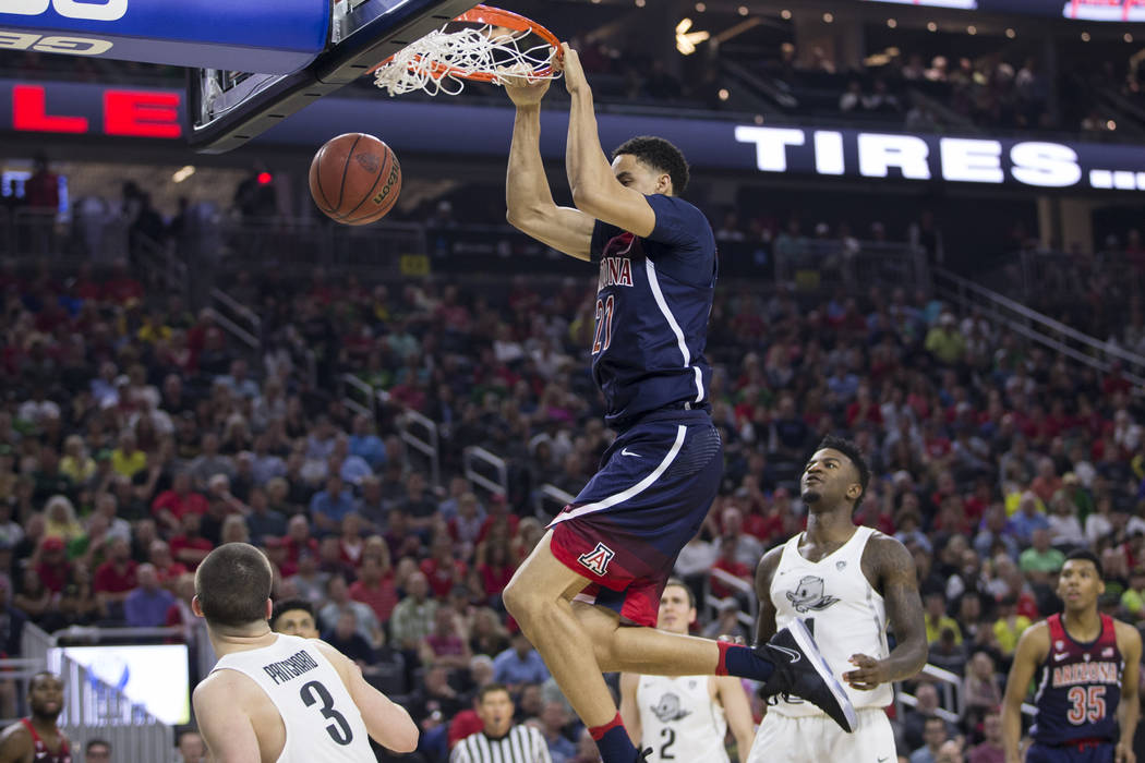 Arizona Wildcats center Chance Comanche (21) dunks the ball against Oregon Ducks in an NCAA college basketball game for the Pac-12 tournament championship at T-Mobile Arena Saturday, March 11, 201 ...