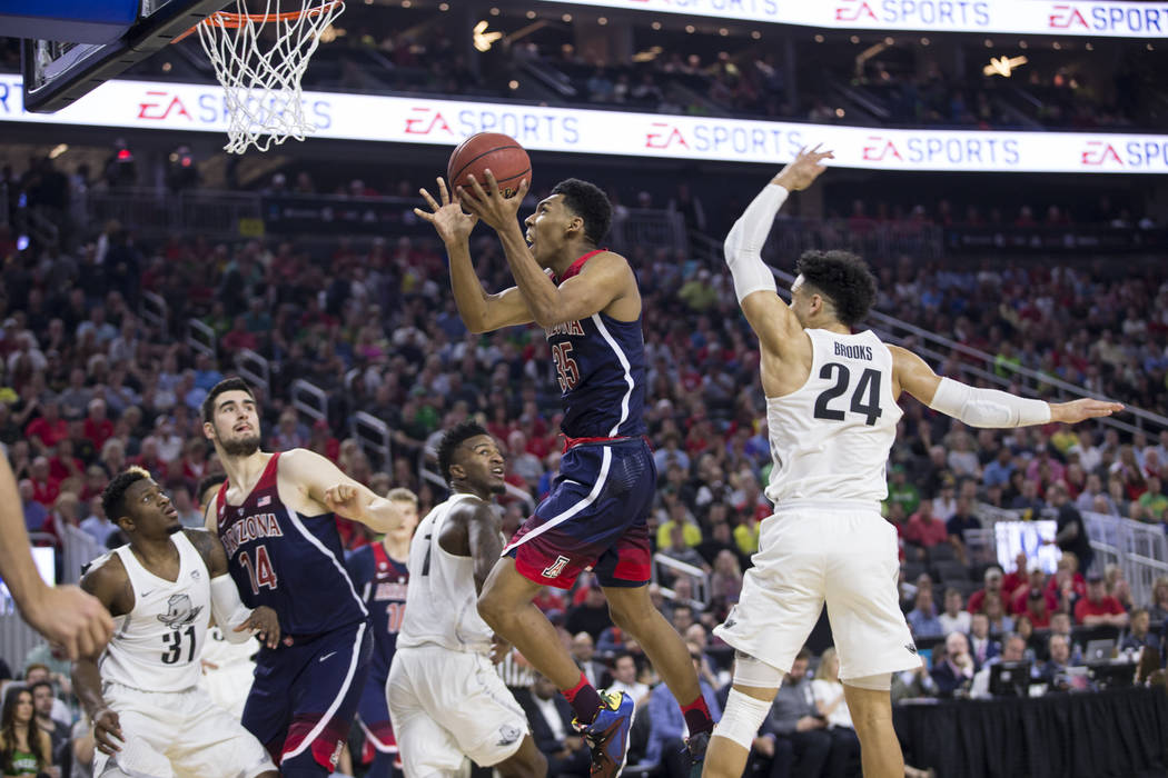 Arizona Wildcats guard Allonzo Trier (35) goes up for a shot against Oregon Ducks in an NCAA college basketball game for the Pac-12 tournament championship at T-Mobile Arena Saturday, March 11, 20 ...
