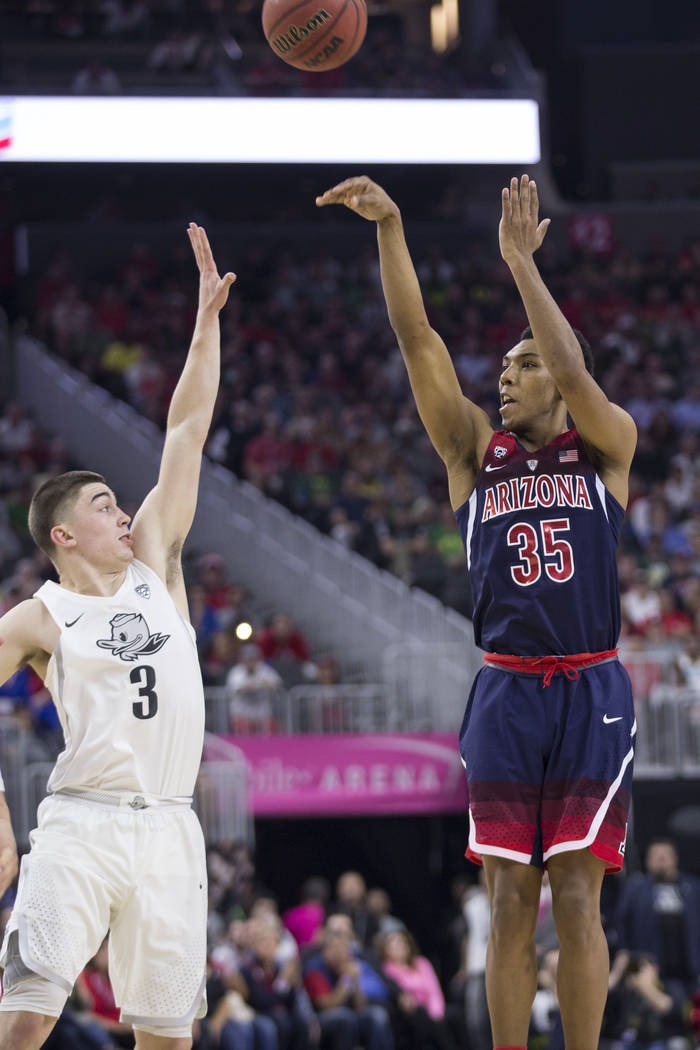 Arizona Wildcats guard Allonzo Trier (35) shoots the ball against Oregon Ducks guard Payton Pritchard (3) in an NCAA college basketball game for the Pac-12 tournament championship at T-Mobile Aren ...