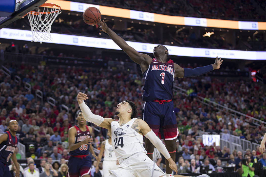 Arizona Wildcats guard Rawle Alkins (1) blocks a shot by Oregon Ducks forward Dillon Brooks (24) in an NCAA college basketball game for the Pac-12 tournament championship at T-Mobile Arena Saturda ...