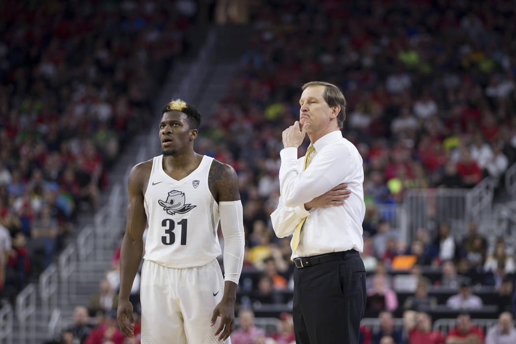Oregon Ducks guard Dylan Ennis (31) head coach Dana Altman look on during their game against Arizona Wildcats in an NCAA college basketball game for the Pac-12 tournament championship at T-Mobile  ...