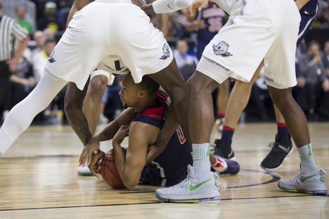 Arizona Wildcats guard Parker Jackson-Cartwright (0) holds the ball on the floor against Oregon Ducks in an NCAA college basketball game for the Pac-12 tournament championship at T-Mobile Arena Sa ...