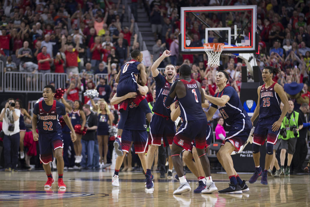 Arizona Wildcats celebrate their victory against Oregon Ducks in an NCAA college basketball game for the Pac-12 tournament championship at T-Mobile Arena Saturday, March 11, 2017, in Las Vegas. Ar ...