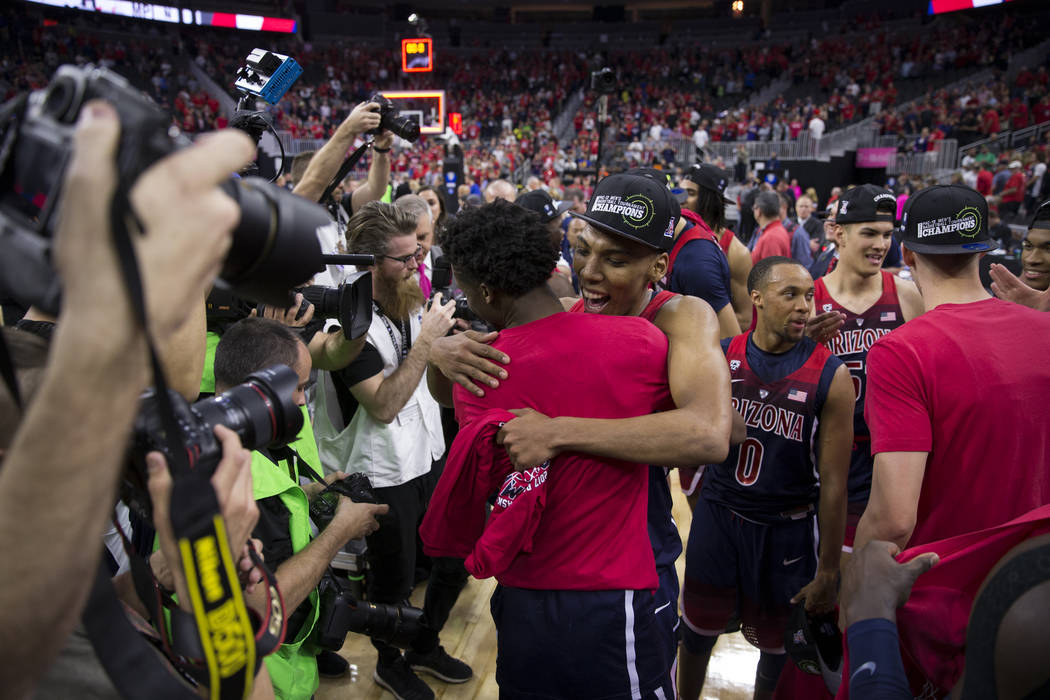 Arizona Wildcats guard Allonzo Trier (35) hugs a teammate after his team's victory against Oregon Ducks in an NCAA college basketball game for the Pac-12 tournament championship at T-Mobile Arena  ...