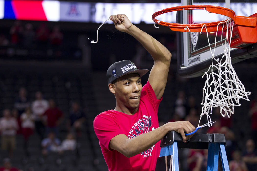 Arizona Wildcats guard Allonzo Trier (35) holds up a piece of the net after his team's victory against Oregon Ducks in an NCAA college basketball game for the Pac-12 tournament championship at T-M ...