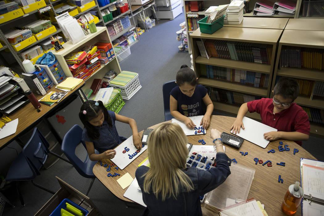 Growth analyst teacher Sara Boucher works on reading and spelling skills with third grade students from left, Jacqueline Martinez, Jalessa Rojo and Luis Wong at Wynn Elementary School on Thursday, ...