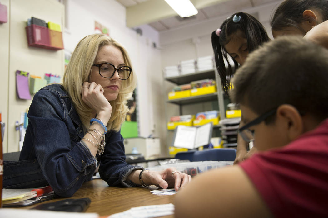Growth analyst teacher Sara Boucher works on the reading and spelling skills of third grade students at Wynn Elementary School on Thursday, March 9, 2017, in Las Vegas. (Erik Verduzco/Las Vegas Re ...