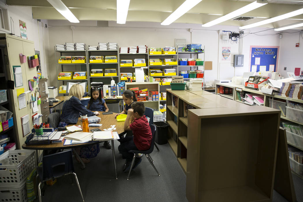 Growth analyst teacher Sara Boucher, from left, works on reading and spelling skills with third grade students Jacqueline Martinez, Jalessa Rojo and Luis Wong at Wynn Elementary School on Thursday ...