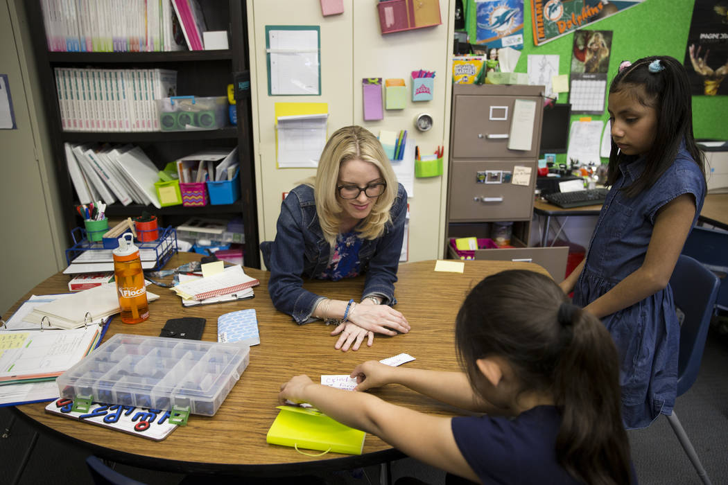 Growth analyst teacher Sara Boucher works on the reading and spelling skills of third grade student Jalessa Rojo, center, and Jacqueline Martinez at Wynn Elementary School on Thursday, March 9, 20 ...