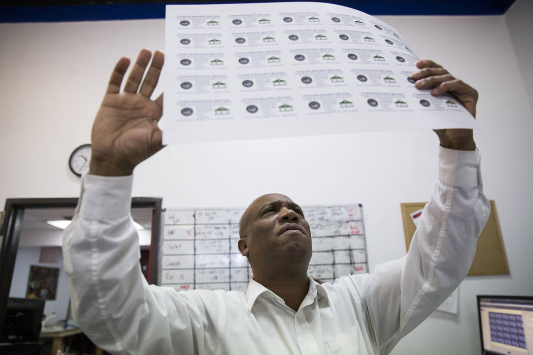 John Pinnington, owner of AA Printing, shows how to look for print quality at his business on Tuesday, March 7, 2017, in Las Vegas. (Erik Verduzco/Las Vegas Review-Journal) @Erik_Verduzco