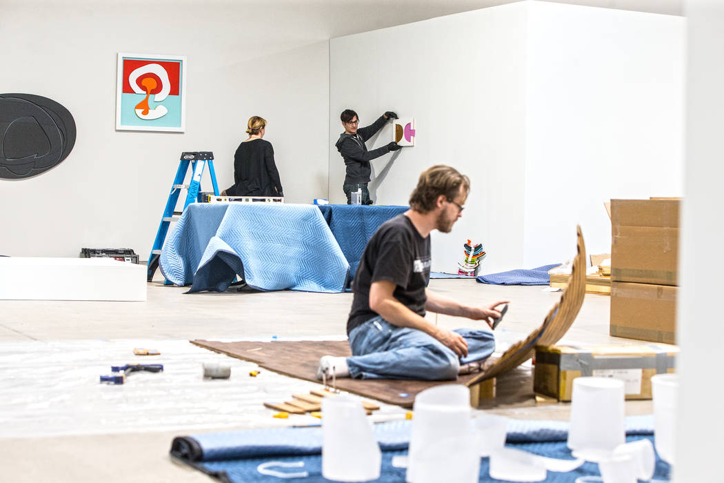"Michele Quinn, David Ryan and Brent Summerhauser work at the site of a warehouse pop-up museum at 920 South Commerce Street created to feature the exhibit ""Tilting the Basin"" on  ..."