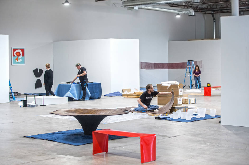 "Michele Quinn, Sean Hummel and Brent Summerhauser work on an installation at the site of a warehouse pop-up museum at 920 South Commerce Street created to feature the exhibit ""Tilting the ..."