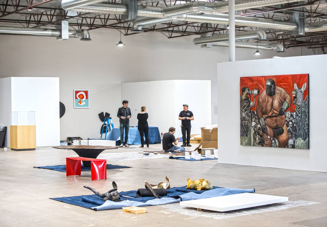 David Ryan, Michele Quinn, Brent Summerhauser and Sean Hummel work on an installation at the site of a warehouse pop-up museum at 920 South Commerce Street created to feature the exhibit &quot ...