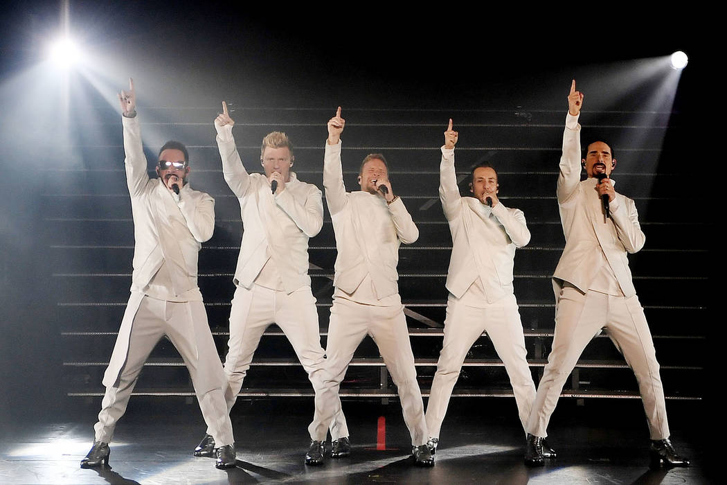 """Singers AJ McLean, Nick Carter, Brian Littrell, Howie Dorough and Kevin Richardson of the Backstreet Boys perform during the launch of the group's residency """"Larger Than Life"""" at The Axis at Plane ..."""