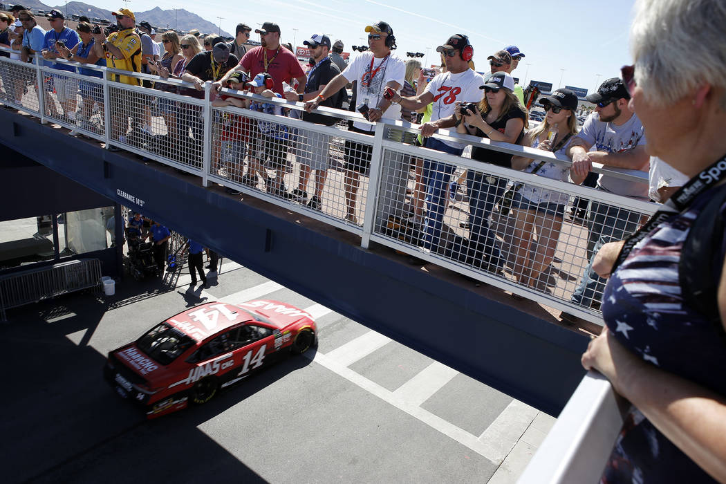 Onlookers watch as JJ Yeley car passes before a NASCAR Xfinity Series auto race at Las Vegas Motor Speedway Saturday, March 11, 2017, in Las Vegas. (Christian K. Lee/Las Vegas Review-Journal) @chr ...