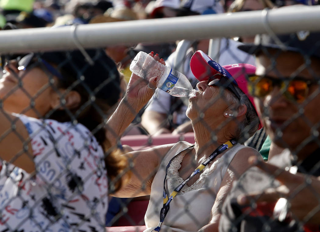 A fan drinks water on a hot day during a NASCAR Xfinity Series auto race at Las Vegas Motor Speedway Saturday, March 11, 2017, in Las Vegas. (Christian K. Lee/Las Vegas Review-Journal) @chrisklee_jpeg