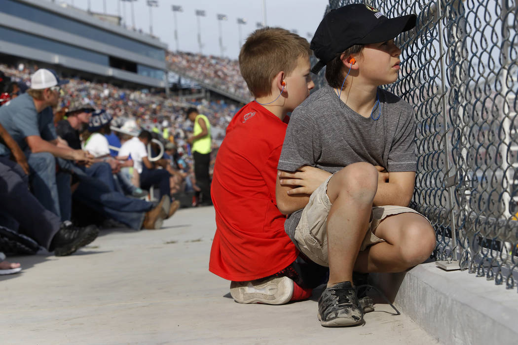 Ethan Woodley, 10, left, and Roman Handy, 10, watches a NASCAR Xfinity Series auto race at Las Vegas Motor Speedway Saturday, March 11, 2017, in Las Vegas. (Christian K. Lee/Las Vegas Review-Journ ...