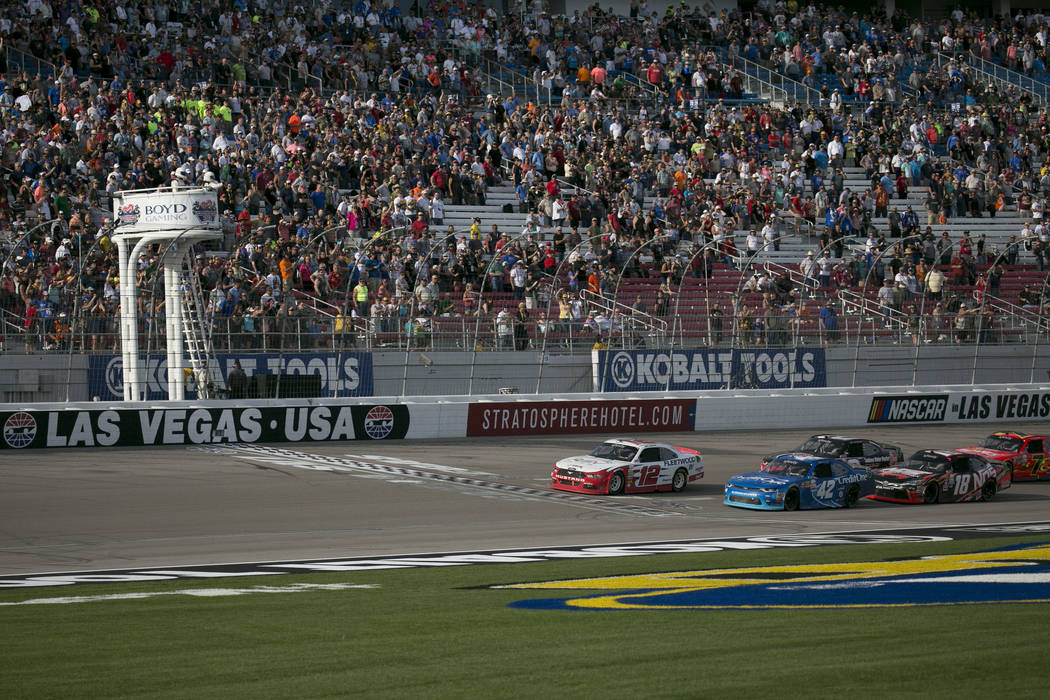 Driver Joey Logano (12) takes the lead during the NASCAR Boyd Gaming 300 auto race at Las Vegas Motor Speedway on Saturday, March 11, 2017, in Las Vegas. (Bridget Bennett/Las Vegas Review-Journal) ...
