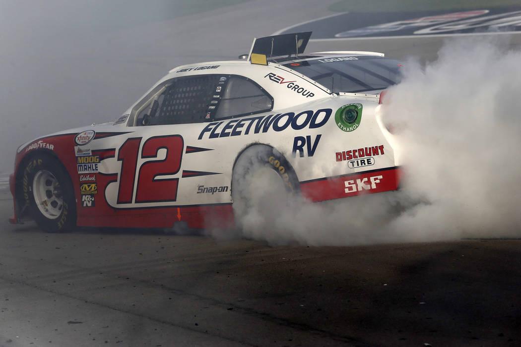 Joey Logano (12) burns out after winning  a NASCAR Xfinity Series auto race at Las Vegas Motor Speedway Saturday, March 11, 2017, in Las Vegas. (Christian K. Lee/Las Vegas Review-Journal) @chriskl ...