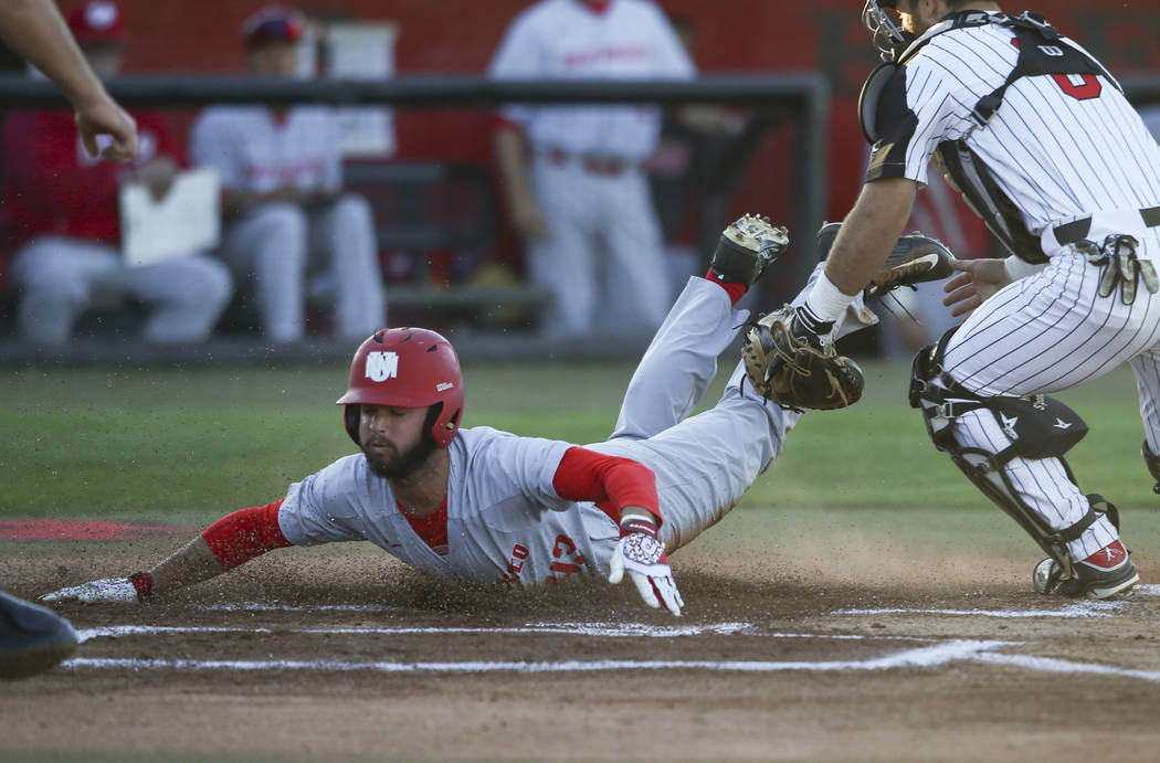 New Mexico outfielder Danny Collier (43) scores a run past UNLV catcher Payton Squier (6) during a baseball game at Wilson Stadium in Las Vegas on Friday, March 24, 2017. (Chase Stevens/Las Vegas  ...