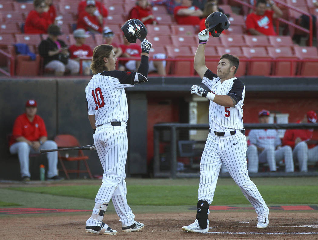 UNLV infielder Kyle Isbel (5) celebrates his home run with UNLV infielder Bryson Stott (10) during a baseball game against New Mexico at Wilson Stadium in Las Vegas on Friday, March 24, 2017. (Cha ...